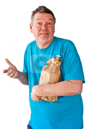 Distraught Mature Man with bottle of booze stock photo, Distraught mature manwith bottle of booze hidden in paper bag, isolated on white background. by Steve Carroll