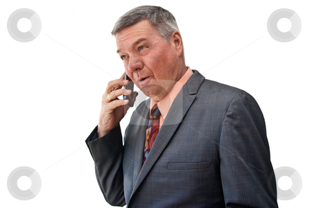 Portrait of Senior Businessman stock photo, Portrait of a senior businessman, 3/4 view, talking on a cell phone, isolated on a white background. by Steve Carroll