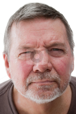 Mature Homeless Man, Close-up stock photo, Mature man of 58 years, with white stubble, looking straight into the camera and squinting. by Steve Carroll