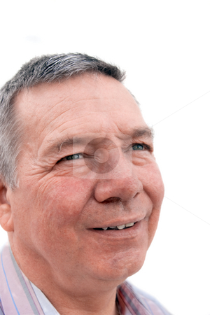 Senior man looking up and smiling stock photo, Head shot of a smiling 57 year old Caucasion man looing up and off into the distance by Steve Carroll