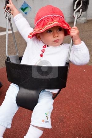 Swing stock photo, Cute little caucasian baby girl having fun on a swing by Mariusz Jurgielewicz