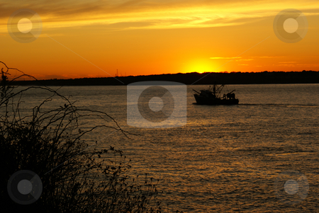 Sunset Ship stock photo, Silhouette of a cargo ship at sunset by Daniel Rosner