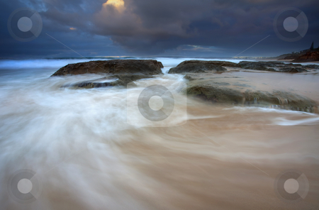 Ebb Tide Sunrise stock photo, A stormy surnise as ebbing tides swirl around rocks on Knights beach in South Australia by Mike Dawson