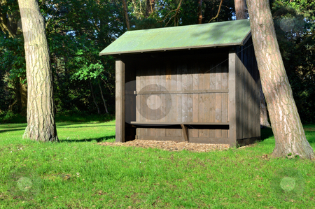 Wooden Shelter on Golf Course stock photo, Wooden Shelter for relaxing set on a rural golf course by Robert Ford