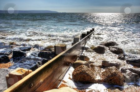 Seashore Groyne stock photo, Groyne with surrounding rocks enhanced to HDR effect by Robert Ford
