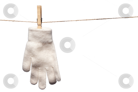 A single white winter glove hanging on a clothesline stock photo, A horizontal image of a single white winter glove hanging on a clothes line by Vince Clements