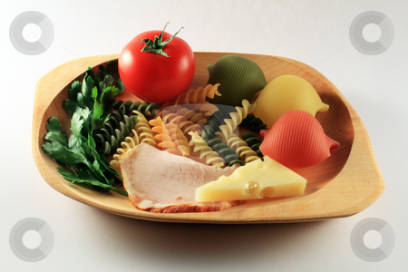 Healthy food ingredients on plate stock photo, Tomato, pasta, ham, cheese on woodden plate by Varga S??ndor