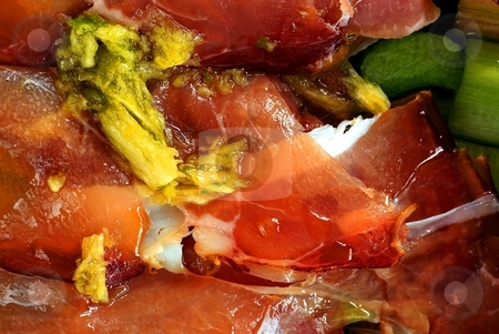 Prosciutto with garlic stock photo, Detail of fresh prosciutto before baking with oil, herbs, garlic by Juraj Kovacik