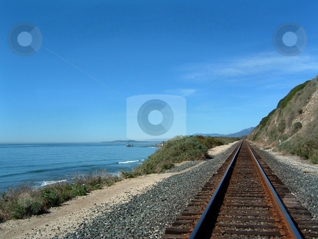 Costal Train Tracks stock photo, Costal train tracks with the ocean on the side and a blue sky. by Henrik Lehnerer