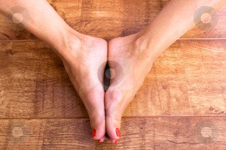 Feet Together stock photo, Two feet placed together on a wodden background by Keith Wilson