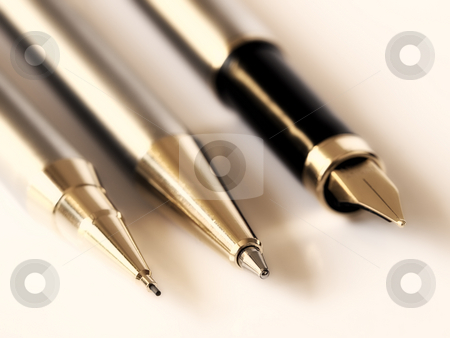 Stationery stock photo, Closeup of three different types of pens in almost every office. Toned image. by Sinisa Botas