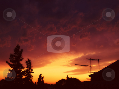 Clouds over city stock photo, View of the tranquil, evening sky above the city after the storm. Toned image. by Sinisa Botas