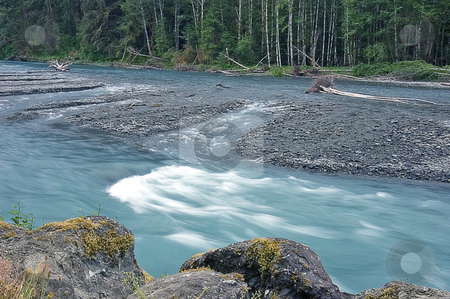 Hoh River in Rainforest stock photo, This photo is Hoh river, located in Hoh rain forest in Washington state located in the Olympic mountains.  Beautiful rushing river with interesting lines in the sand. by Valerie Garner