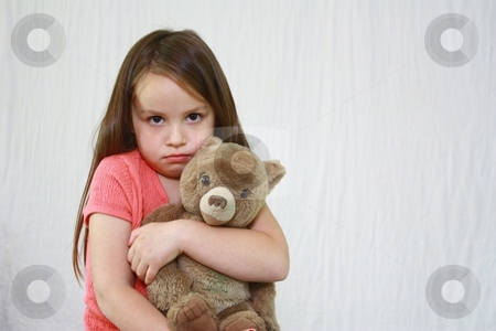Young cute girl hugging little teddybear. stock photo, Young girl with teddybear by Gregory Dean