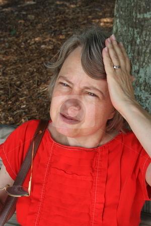 Headache stock photo, Woman complaining of a sudden headache by Jack Schiffer