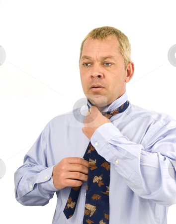 Businessman preparing for work stock photo, Business man preparing for work on white background by John Teeter