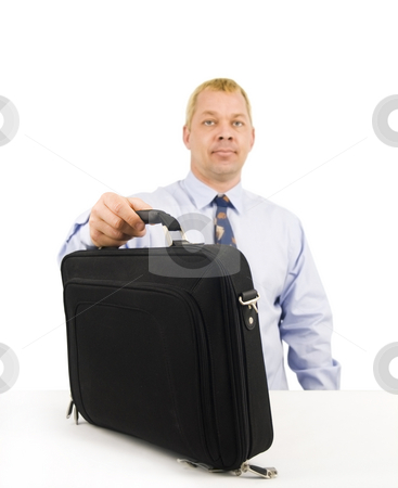 Business man setting down briefcase stock photo, Business man setting down briefcase on white background by John Teeter