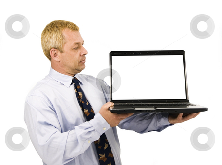 Business man presenting on laptop stock photo, Business man presenting on laptop with white background by John Teeter