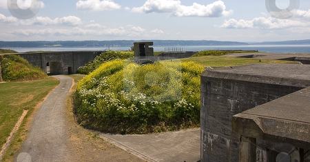 Scenic View At Fort Casey Washington stock photo, A beautiful scene taken at Fort Casey in Washington state overlooking the ocean with parts of the fort and road showing. by Valerie Garner