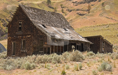 Old Abandoned Mountain Homestead stock photo, This is an old, ancient abandoned homestead building set in the arrid mountains of Washington state. by Valerie Garner