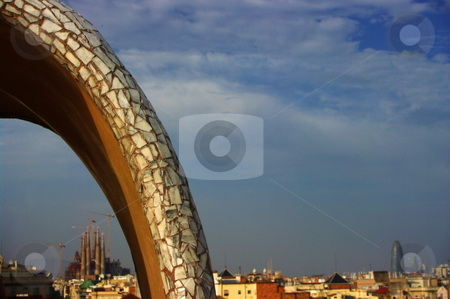 Barcelona Skyline stock photo, Sagrada Fam?lia and Agbar Tower seen through a trencad?s covered Gaudian arch on La Pedrera. Barcelona, Spain by Martin Darley