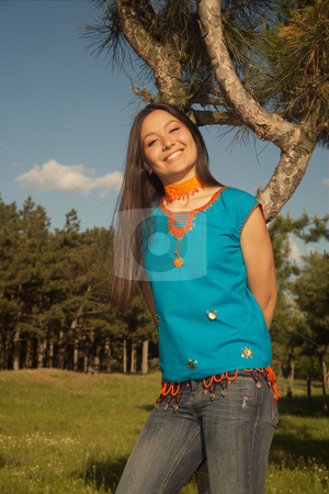 Asian beauty stock photo, Portrait of the beautiful girl on a background of green trees. by Sergey Goruppa