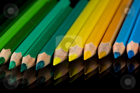 Color pencils stock photo, Palette of color pencils on a black background. by Sergey Goruppa