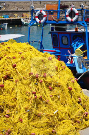 Fishing nets stock photo, Travel photography: Fishing boat and nets. Port of Heraklion, Crete, Greece by Fernando Barozza