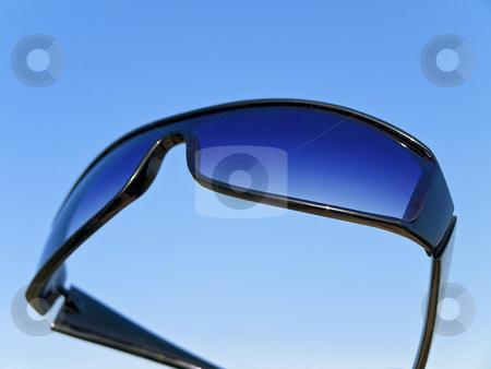 Sun glasses stock photo, Sun glasses against the blue sky by Sergej Razvodovskij