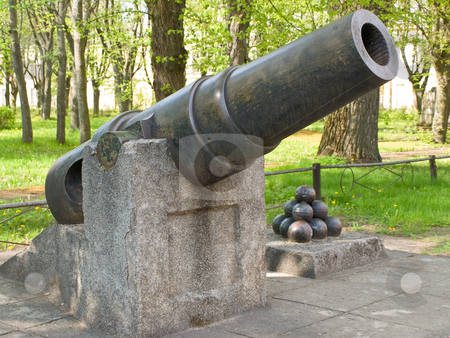 Old canon stock photo, Old canon with canon balls at the city park by Sergej Razvodovskij