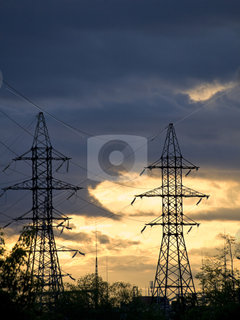 Electricity towers stock photo, Two electricity towers against the night sky by Sergej Razvodovskij