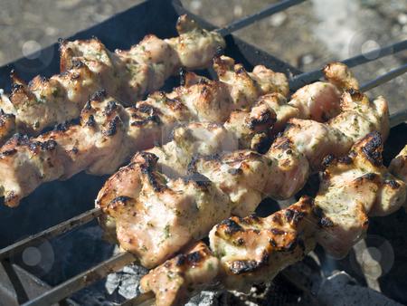 Shish kebab  stock photo, Shish kebab preparing at the chargrill outdoor by Sergej Razvodovskij
