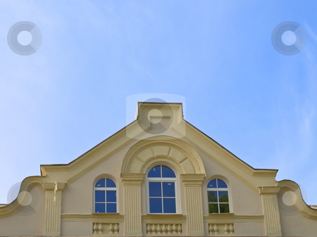 Attic stock photo, Front elevation of a penthouse against blue sky by Sergej Razvodovskij