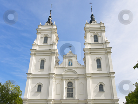 White Church  stock photo, White Church against the blue cloudy sky by Sergej Razvodovskij