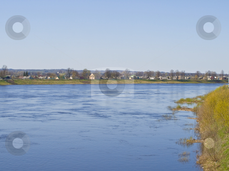 River stock photo, Blue river with houses at the brinks with grass by Sergej Razvodovskij