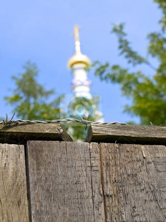 Dannert wire stock photo, Part of a dannert wire against the churhch background by Sergej Razvodovskij
