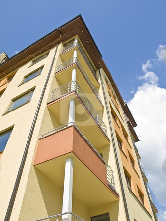 Flat building stock photo, Flat building against the blue sky with clouds by Sergej Razvodovskij