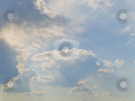 Sun and clouds stock photo, Clouds at the blue sky with sun shaft by Sergej Razvodovskij