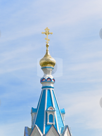 Oriental Church cupola stock photo, Oriental Church golden cupola against the blue sky by Sergej Razvodovskij