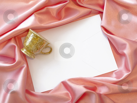 Textile border with mug stock photo, Pink silk textile border round white paper with mug by Sergej Razvodovskij