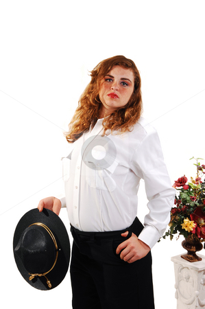 Pretty security guard. stock photo, A lovely security guard from an shopping mall in the US in her good looking uniform with bright red hair and her hat in the hand. by Horst Petzold