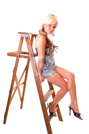 Girl on stepladder. stock photo, Pretty young girl in a black and white top and shorts with long blond hair sitting on the wooden stepladder, looking in the camera. by Horst Petzold
