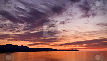 Strait of Juan de Fuca Sunset stock photo, A beautiful sunset over the Strait of Juan de Fuca in Sequim. Panoramic photo. by Travis Manley