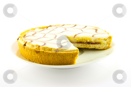 Bakewell Tart stock photo, Delicious looking iced bakewell tart on a white plate with a plain background by Keith Wilson