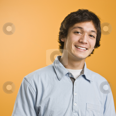 Attractive male smiling stock photo, Attractive male smiling at camera, torso shot. Wearing a blue button down. Square. by Jonathan Ross