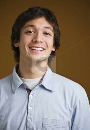 Brunette male smiling stock photo, Attractive brunette young male facing the camera, wearing a button down shirt. vertical by Jonathan Ross