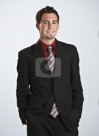 Attractive male looking at the camera stock photo, Attractive male looking at the camera, smiling. 3/4 body shot frontal view. Vertical by Jonathan Ross