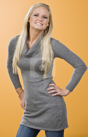Attractive blond posing stock photo, Attractive blond posing for camera with hip cocked to the right, facing the camera and arm bent. vertical by Jonathan Ross