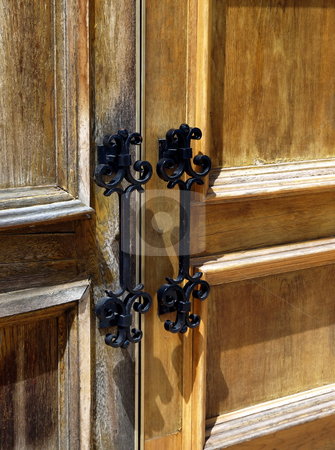 Close-up of weathered wooden double doors and iron handles stock photo, Weathered wooden double doors with iron metal handles by Jill Reid