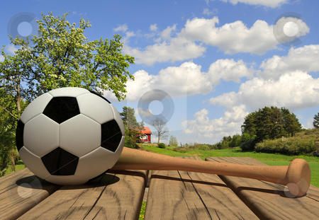 Summer sports stock photo, Wodden table with soccerball and baseball bat. 3d render by Magnus Johansson